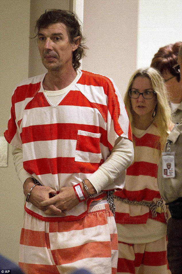 Shackled: Paul and Sheila Comer are led into Georgia courtroom for a hearing. They have been charged with child abuse
