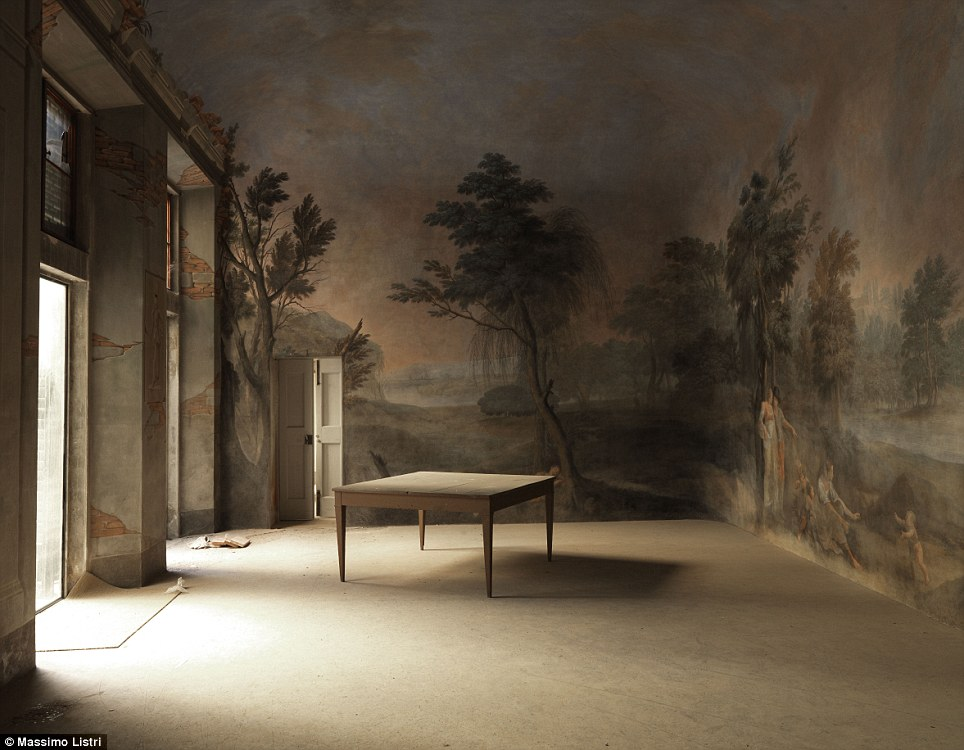 Less austere: This room in the Palazzo Martelli in Florence shows a painted mural on the wall, but a room void of furniture, save for one lone wooden table