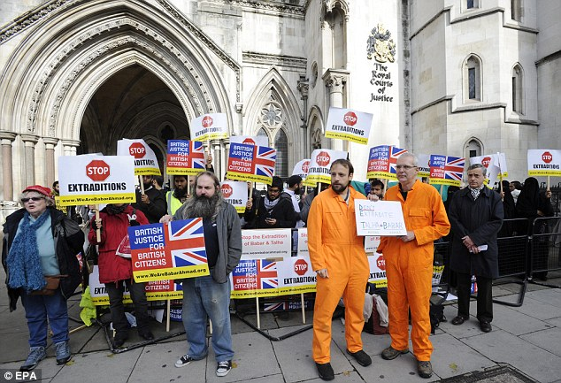 Campaign: Demonstrators hold banners calling for a stop to extraditions outside The Royal Courts of Justice in London