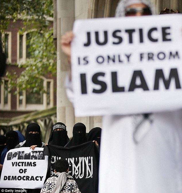 'Justice is only from Islam': Protestors demonstrate against the intended extradition of Abu Hamza to America on terrorism charges outside the Royal Courts of Justice
