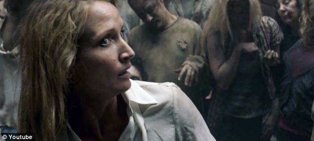 She's alive! The zombies have managed to save the woman from dying from a heart attack