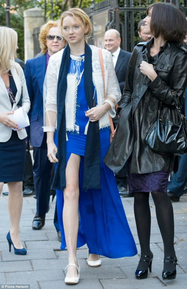 Lily Cole, the model and actress, wearing an electric blue dress, and Mick Hucknall, former lead singer of Simply Red, behind, were among the celebrities who attended