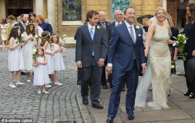 The newlyweds and their guests, including the bridal party, pose for pictures outside Wesley's Church in London on Saturday
