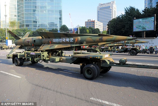 South Korea, pictured displaying missiles with a maximum range of 180 kilometers during a parade marking the country's Armed Forces Day in Seoul, has made a deal with the U.S. to nearly triple the range of its missiles