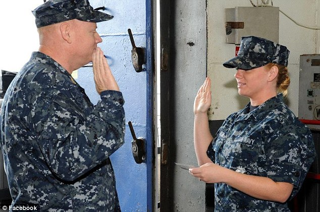 Honor: Breanna Janssen reads the Oath of Enlistment to her father David
