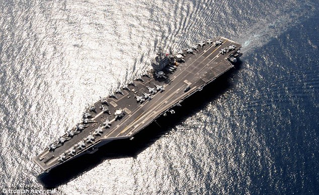 Deployment: Father and daughter are serving on the USS Harry S Truman, a nuclear-powered aircraft carrier