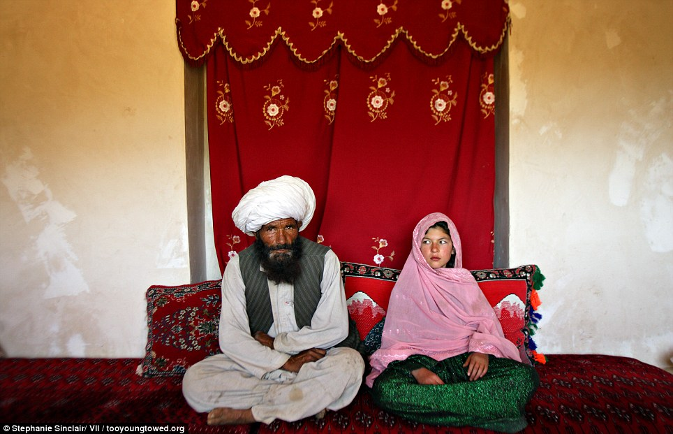 Disturbing: Faiz, 40 (left), and Ghulam (right), 11, sit in her home prior to their wedding in the rural Damarda Village, Afghanistan on September 11, 2005