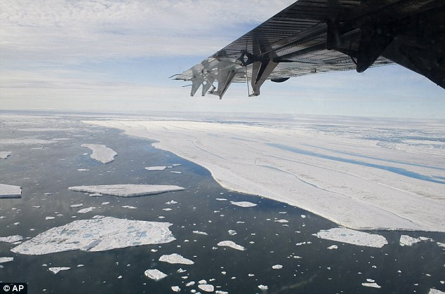 Surprising: News that the world has got no warmer for the past 16 years will come as something of a shock. This picture shows drifting ice in Canada