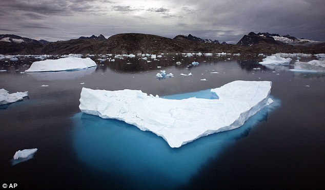 Warmer: Since 1880 the world has warmed by 0.75 degrees Celsius. This image shows floating icebergs in Greenland