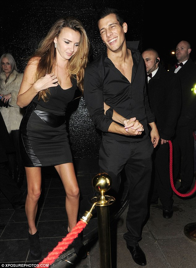 Smitten: Nadine Coyle leaves a London nightclub with her new boyfriend Waz Ashayer looking delighted
