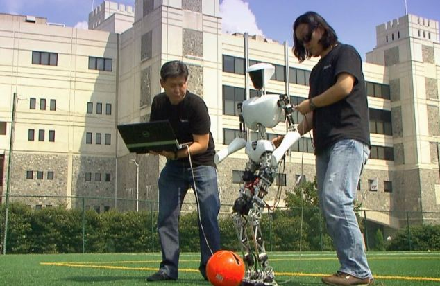 Engineers test out the new robot's movement using a football