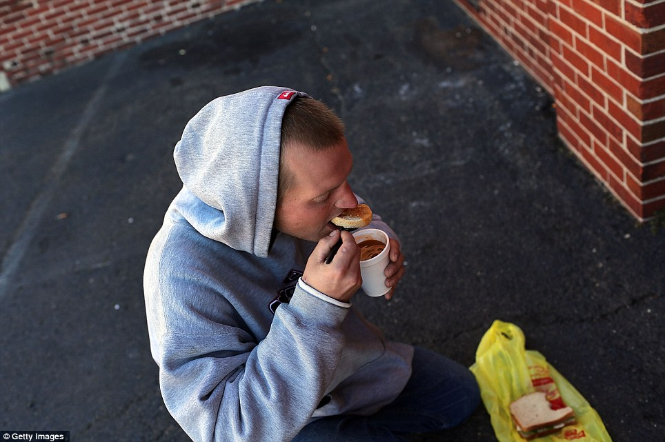 Reformed drug addict Bill Karwoski Jr. eats a free meal from Cathedral Hall