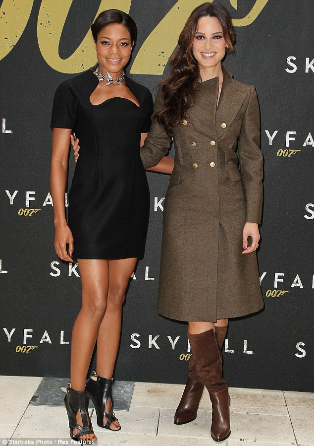Bond girls: Naomie Harris and Bérénice Marlohe opted for very different looks as they attended a photocall for upcoming 007 movie Skyfall in New York City on Monday