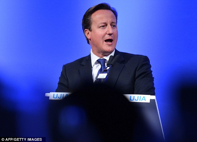 Prime Minister: David Cameron speaks at the annual United Jewish Israel Appeal dinner in London last night
