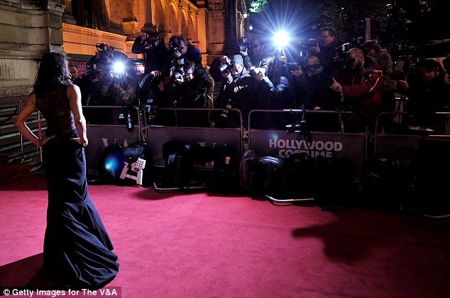 Hollywood glamour: Michelle looked effortlessly elegant as she posed for photographs at London's Victoria and Albert museum