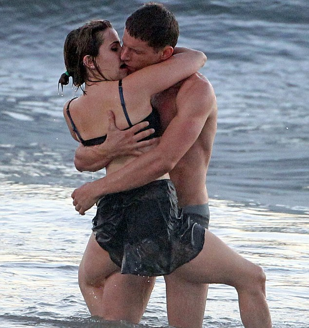 Kiss:The pair make a display of the wild passion for the water scene