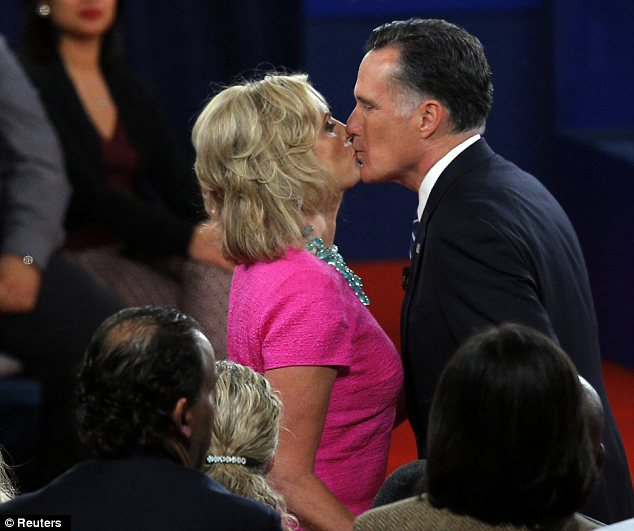 Relief: The GOP candidate kisses his wife Ann on stage at the end of the evening's proceedings