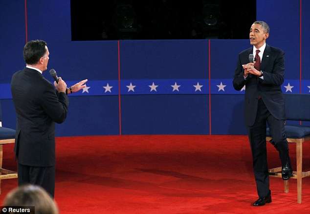 Fighting talk: Romney and Obama clash during the debate, with the President on more aggressive form than the first time they met