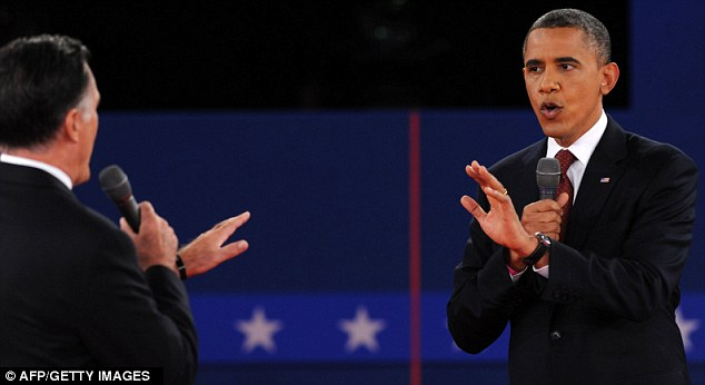 At loggerheads: Both candidates talk at once as they disagree over how Obama handled the Benghazi attack