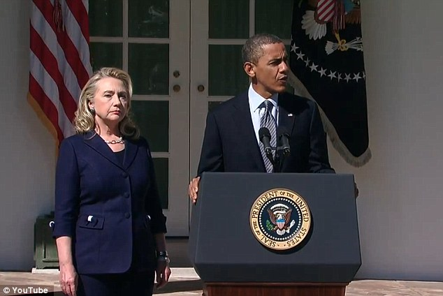 Rose Garden: Obama with Hillary Clinton on September 12, the day after the Libya attacks. He used the phrase 'acts of terror' but Romney last night claimed this was not specifically about the killings in Benghazi
