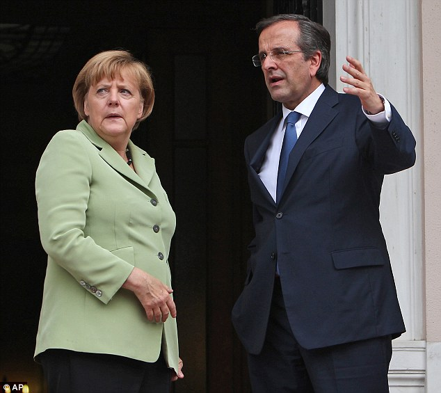 Summit: Greece's Prime Minister Antonis Samaras (right) and Germany's Chancellor Angela Merkel (left) speak before their meeting in Athens earlier this month
