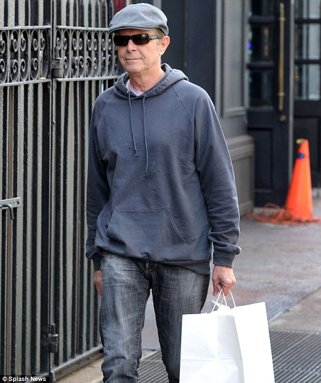 Rare appearance: Reclusive David Bowie was seen picking up some takeout lunch in New York on Wednesday