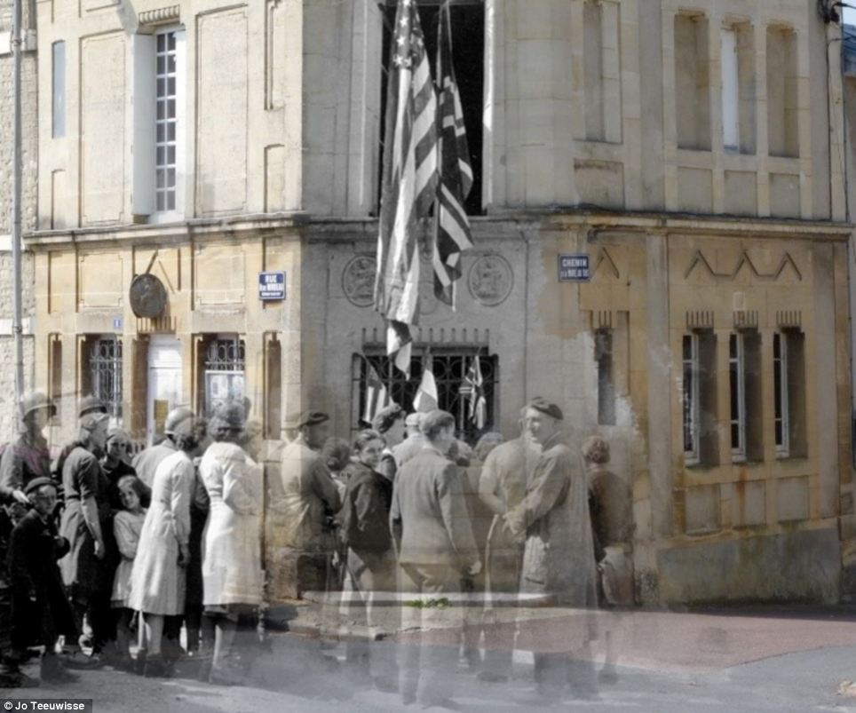 New world: An American flag speaks of Allied progress in this engrossing image from the streets of France