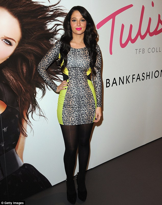 Wild thing: Tulisa shows off one of her new designs at the launch of her Tulisa for Bank pop-up store in Westfield, West London