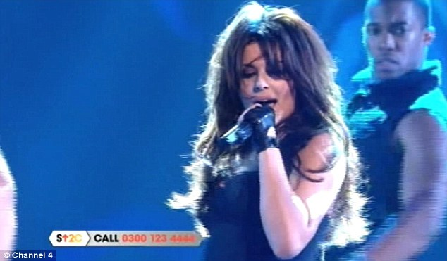 What happened? Cheryl Cole's mic appeared to fail as she took to the stage to open Stand Up To Cancer