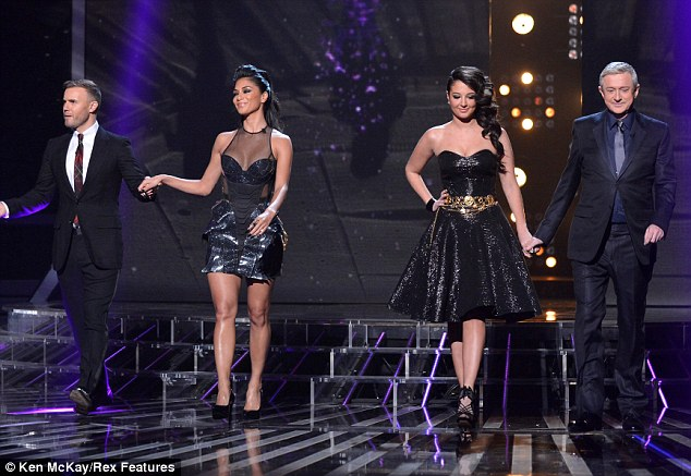 Fashion factor: The judges make their entrance on Sunday night's live show