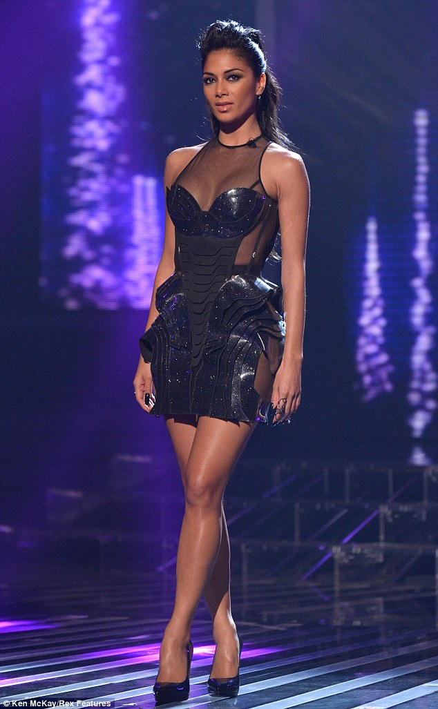 Style war: Nicole Scherzinger opts for a revealing plastic dress for Sunday night's live show