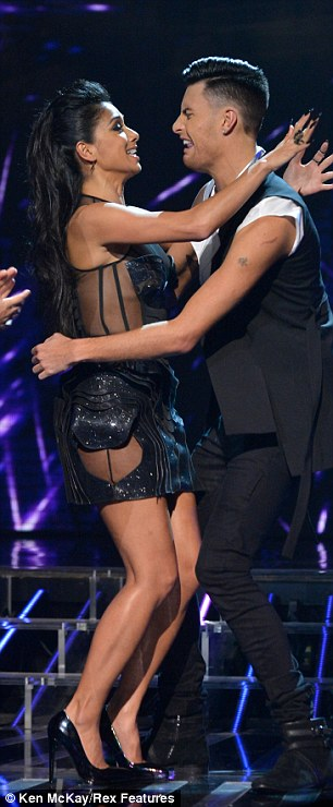 Daring to bare: Nicole flashes some flesh through the sheer side panels of her futuristic dress
