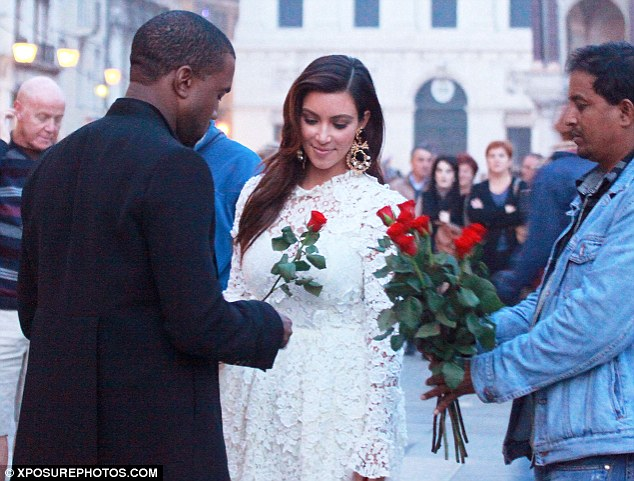 Roses are red ...: Kanye West treats birthday girl Kim Kardashian to a rose in Venice on Sunday