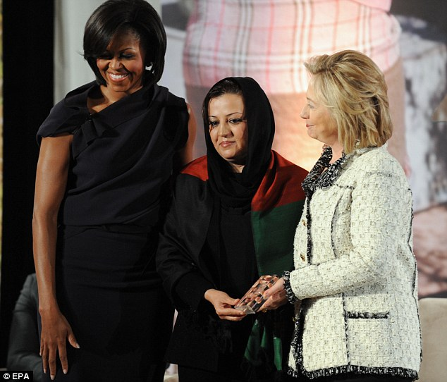 Defender or jailer? Maria Bashir, pictured with with First Lady Michelle Obama U.S. Secretary of State Hillary Clinton, has jailed more than 100 women for adultery in Afghanistan