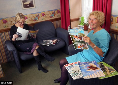 Guidance: Dentist Monica Symes (right) sits in the waiting room of her Lyme Regis surgery with a selection of magazines. She has been advised to throw them out after a week