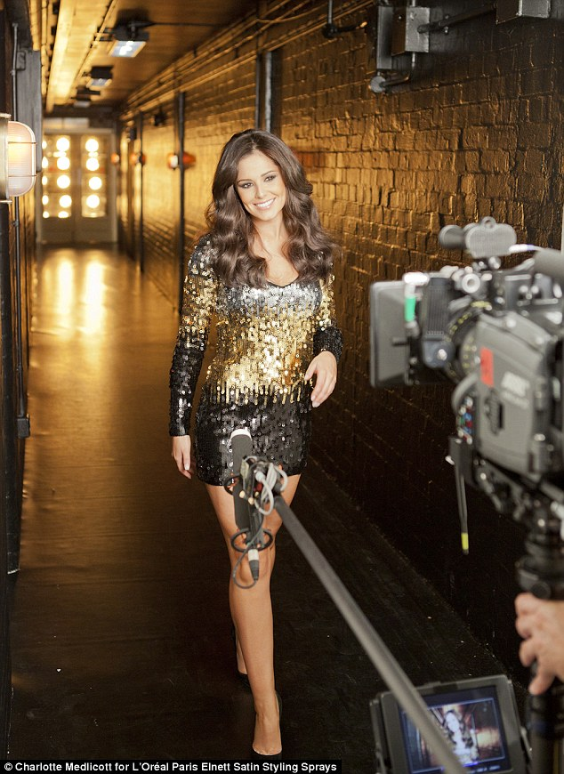She is worth it: Cheryl showed off a sleeker style too as she glowed radiantly for the camera