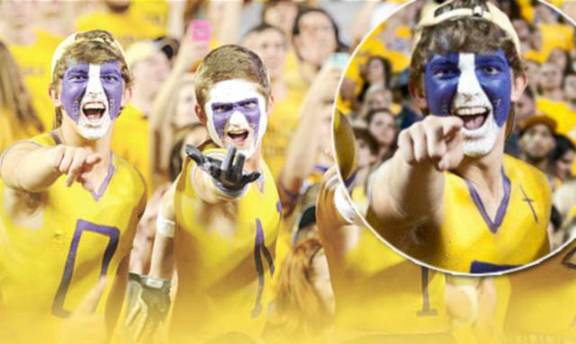 The Painted Posse attend every Tigers game with their bare chests painted with the team's colours - yellow and purple - with a small cross added above their hearts.