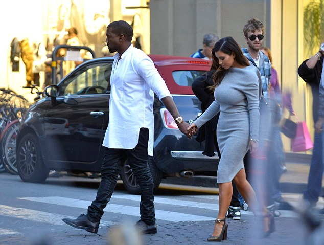 Birthday treat: Kim showed off her figure to the max during their latest Italian outing, while Kanye opted for leather trousers and a white kaftan-style shirt
