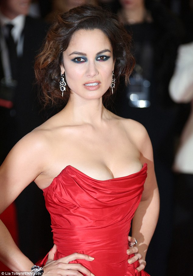 Showing how she bagged the role: Berenice looked ravishing in red as she showed up to the Royal Albert Halll in a strapless gown