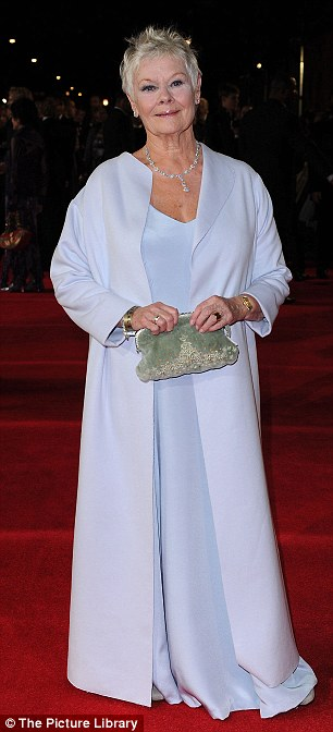 Leading lady: Dame Judi Dench went for a white frock as she showed up to her umpteenth Bond premiere