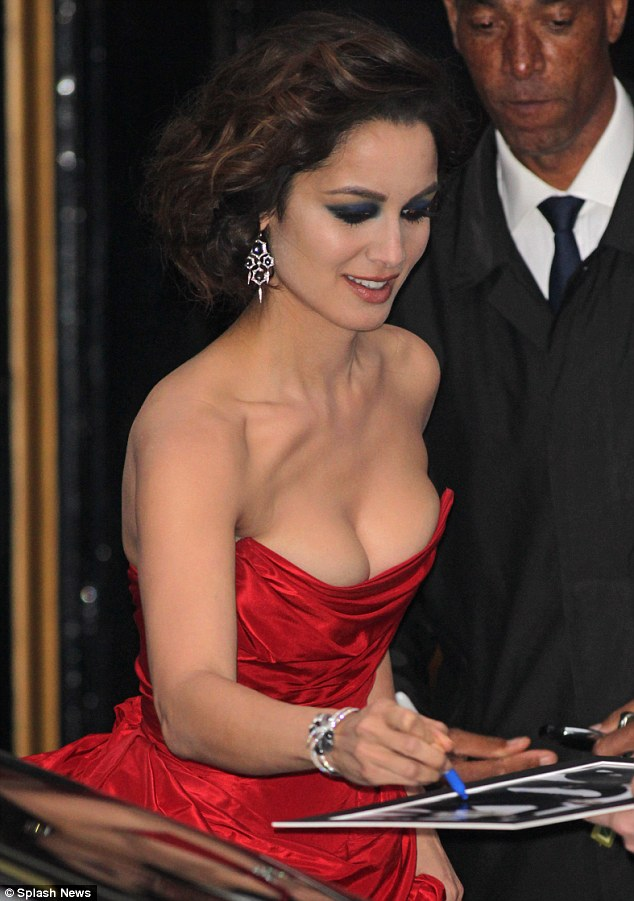 Busting out: Berenice showed off her striking assets in the scarlet gown as she signed autographs for waiting fans