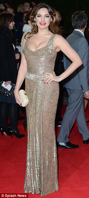 Stunning: Kelly Brook vamped up the glamour in a shimmering gown which accentuated her cleavage, while Tess Daly showed of her svelte frame in an optical illusion monochrome dress