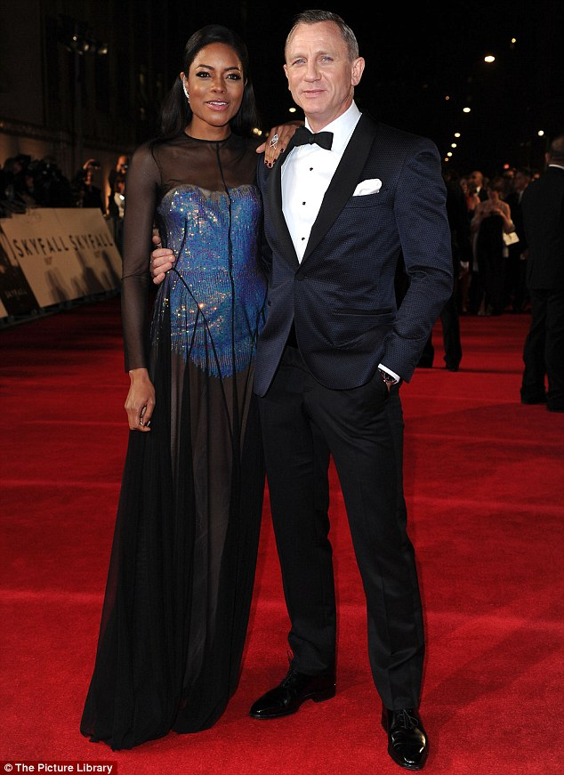 My turn! Fellow Bond Girl Naomie Harris jumped in to pose alongside the leading man