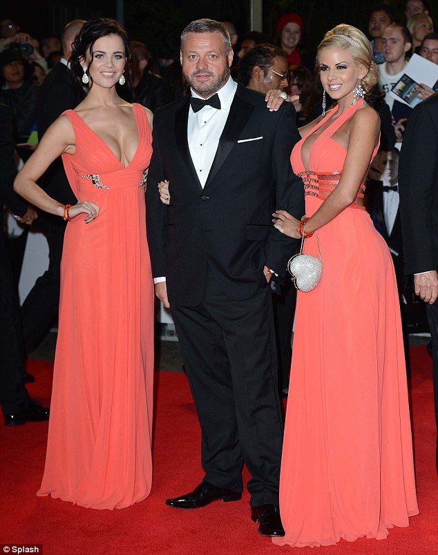 Bringing his own Bond Girls: TOWIE's Mick Norcross tried to act like Bond by wearing a bow tie and arriving flanked by ladies