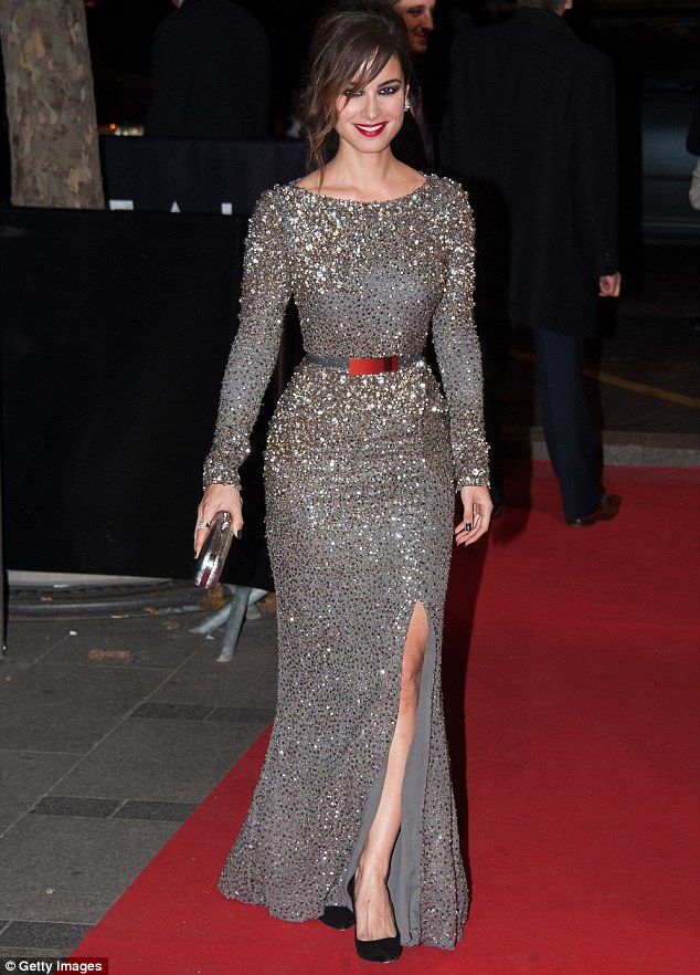 Keeping up the good name: Berenice Marlohe shows off why she's the new Bond Girl on the red carpet for the Paris Skyfall premiere