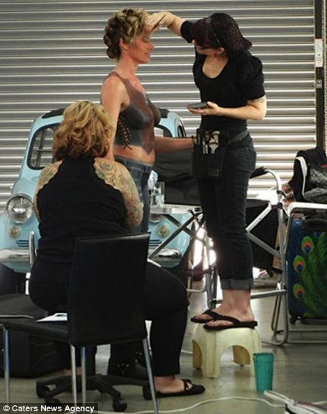 Erin Bates being prepared by a makeup artist