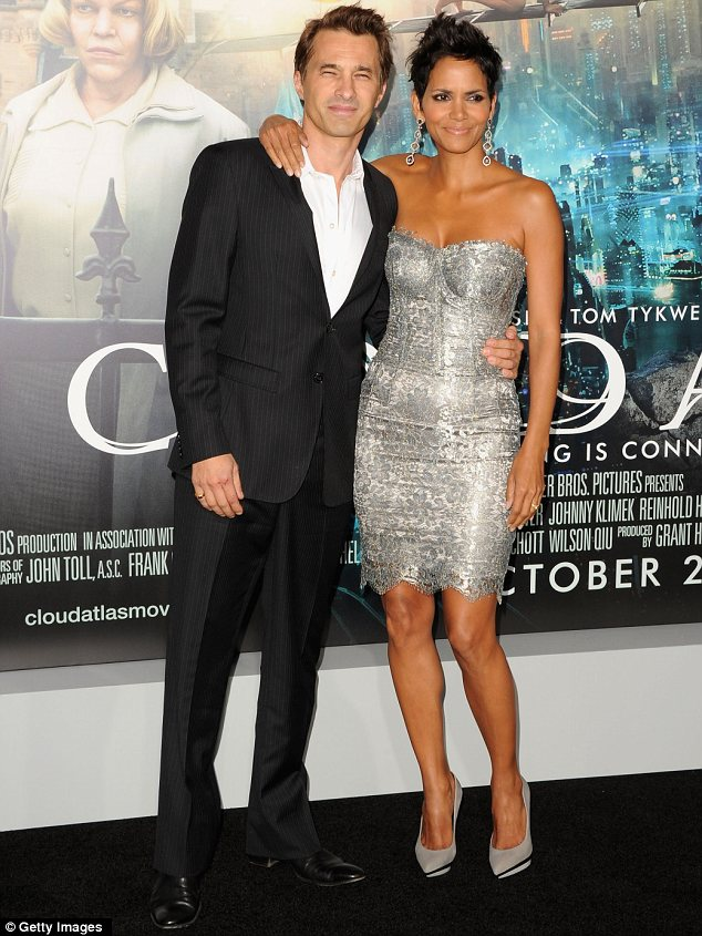 Best supporting fiance: Halle was joined by her French actor beau Olivier Martinez on the red carpet