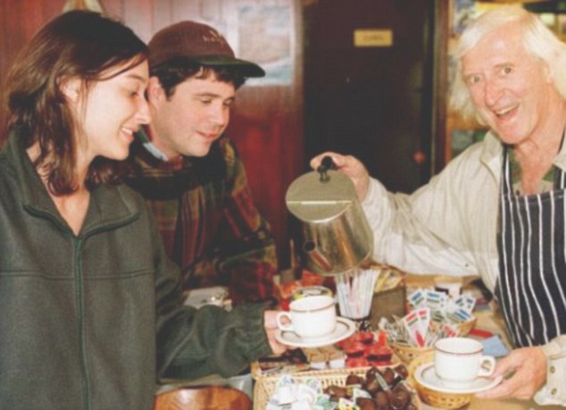 Reputation: Savile was known to show off when in Glencoe, especially to tourists, pictured here serving tea to American honeymoon couple Brian and Rebekah Morovitz at a Highland restaurant