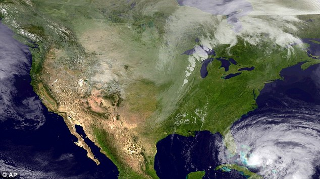 Projection: A satellite image taken Thursday shows the massive Category One storm as it makes its way north; it could hit by East Coast by Halloween