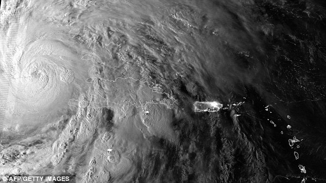 Awesome: A NASA/NOAA image from the Suomi NPP satellite which passed over Hurricane Sandy when it made landfall over Cuba and Jamaica